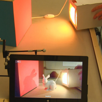 Interactive Near-field Illumination for Photorealistic Augmented Reality on Mobile Devices