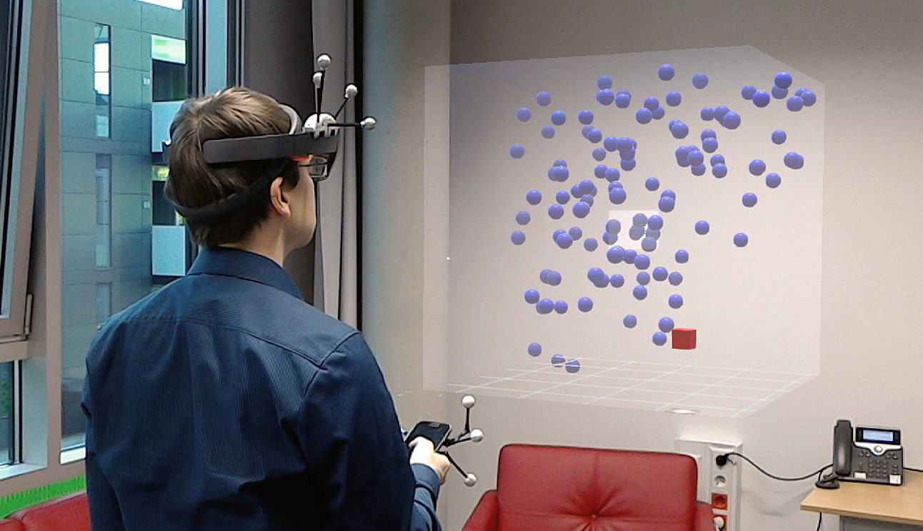 Thumbnail for the accompanying video of our paper 'Investigating Smartphone-based Pan and Zoom in 3D Data Spaces in Augmented Reality', showing a user wearing a HoloLens and using a smartphone to explore an AR data set.